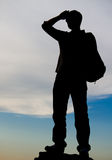 Man standing on top of a rock Stock Photography