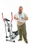Man standing by a training device resting Stock Photos
