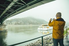 Man standing under the bridge boat in the river Royalty Free Stock Photos