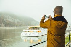 Man standing under the bridge boat in the river Stock Images