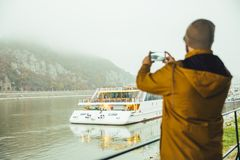 Man standing under the bridge boat in the river Stock Photo