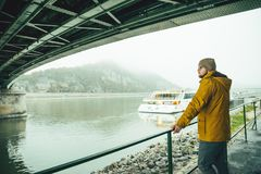 Man standing under the bridge boat in the river Royalty Free Stock Images