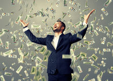Man standing under dollar's rain Royalty Free Stock Photo