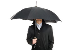 Man standing under an umbrella. Stock Photo