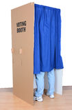 Man Standing in Voting Booth Royalty Free Stock Photos