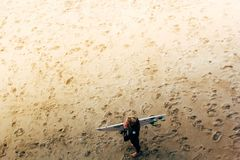 Man Standing Wearing Beach Surf Board Royalty Free Stock Photo