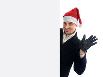 Man standing by white blank card Stock Photography