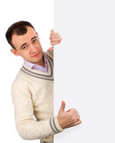 Man standing by white blank card Stock Images