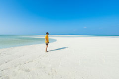 Man standing on white sand beach, Tropical Japan royalty free stock photo