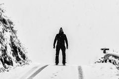 Man Standing on White Snow Covered Ground Beside Mountain Royalty Free Stock Photos