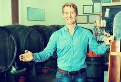 Man standing among wine woods Royalty Free Stock Image