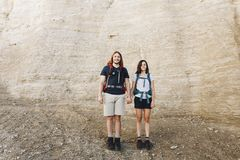 Man Standing Beside Woman on Rocky Range Stock Images