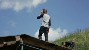 Man standing on a wooden structure on the outdoor. Man standing on a wooden structure view from below on the outdoor stock video