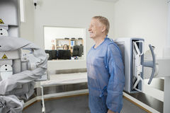 Man Standing At Xray Machine In Hospital Royalty Free Stock Photography