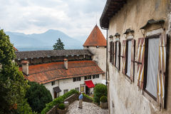 Man standing in the yard of Bled castle Stock Photo