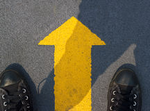 Man standing with yellow arrow move forward to future. Man standing with yellow arrow move forward to the future, Top view Stock Photos
