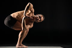 Man standing in yoga position royalty free stock photos