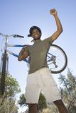 Man Stands With Arm Raised Holding Mountain Bike Stock Images