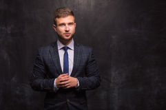 Man stands on a background of chalkboard. Great for any business concepts Stock Photo