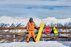 Man stands on backgroung of Krasnaya Polyana mountain resort Stock Photography