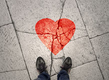 Man stands at broken heart sign Stock Photos
