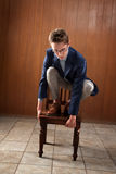 Man Stands On Chair Royalty Free Stock Photos
