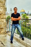 Man stands close to wall of tears. Jerusalem Temple on background Royalty Free Stock Image