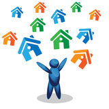 Man stands and colorful house. Royalty Free Stock Image
