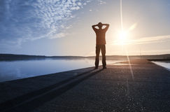 A man stands on the concrete pier in sunshine Royalty Free Stock Photo