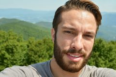 Man stands exhausted after a hike to the end of a trail royalty free stock images