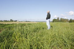 Man Stands in Field Stock Photo