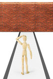 Man stands in front of the brick wall. Abstract image with a wooden puppet Stock Photography