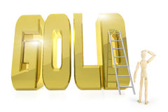 Man stands in front of huge golden word GOLD Royalty Free Stock Photography