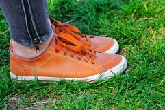 Pair of shoes on green grass stock photo