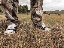 A man stands on a haystack royalty free stock image