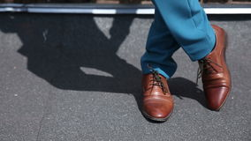 Man stands in his expensive brown shoes. stock video