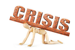 Man stands on his knees under the heavy weight of crisis. Abstract image with a wooden puppet Stock Images