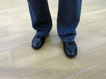 Man stands in jeans and in casual shoes. Man in jeans and everyday shoes. Man in jeans and casual shoes. Male legs in jeans and boots Stock Photos