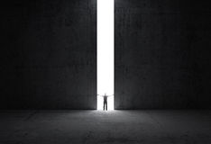 Man stands in the light of the opening Royalty Free Stock Photography