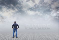 Man stands and looks into an uncertain future. The concept of uncertainty and a vague perspective Stock Photo