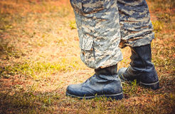 Man stands in military boots and trousers Royalty Free Stock Photography