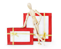 Man stands next to two huge gift boxes Royalty Free Stock Images