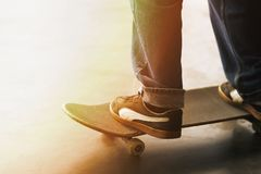 A man stands on an old skateboard royalty free stock image