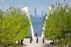Man stands between Postcards, Staten Island September 11 Memorial with Manhattan in distance. New York, USA - June 29, 2018: Man stands between Postcards stock photo