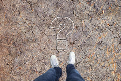 Man stands at question mark icon Stock Photos