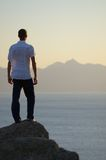 Man stands on a rock Stock Image