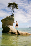 Man stands on an  rock in Abel Tasman Park, New Zealand Stock Image