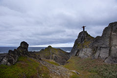A man stands on a rock on the Arctic Coast Stock Photos