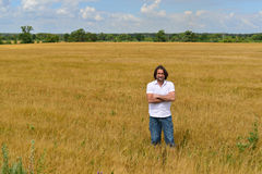 Man stands on the rye field Stock Photos