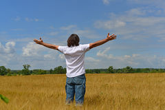 Man stands on the rye field Royalty Free Stock Photo